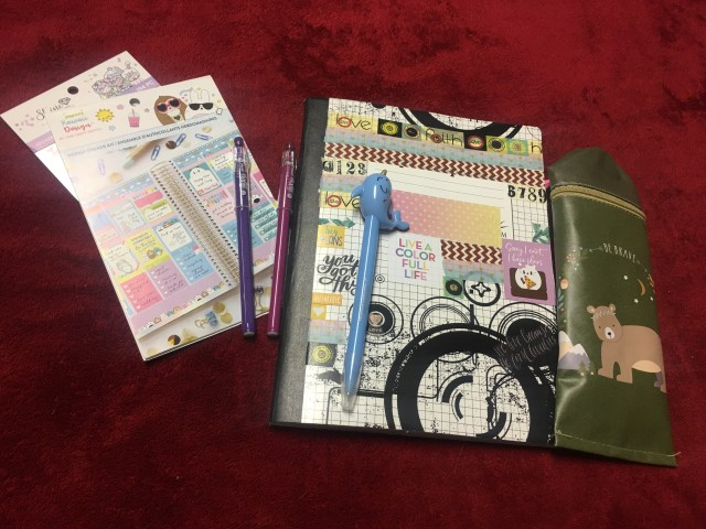 This is my bullet journal, plus some random inexpensive planner accessories. | Photo Credit Heather Patterson