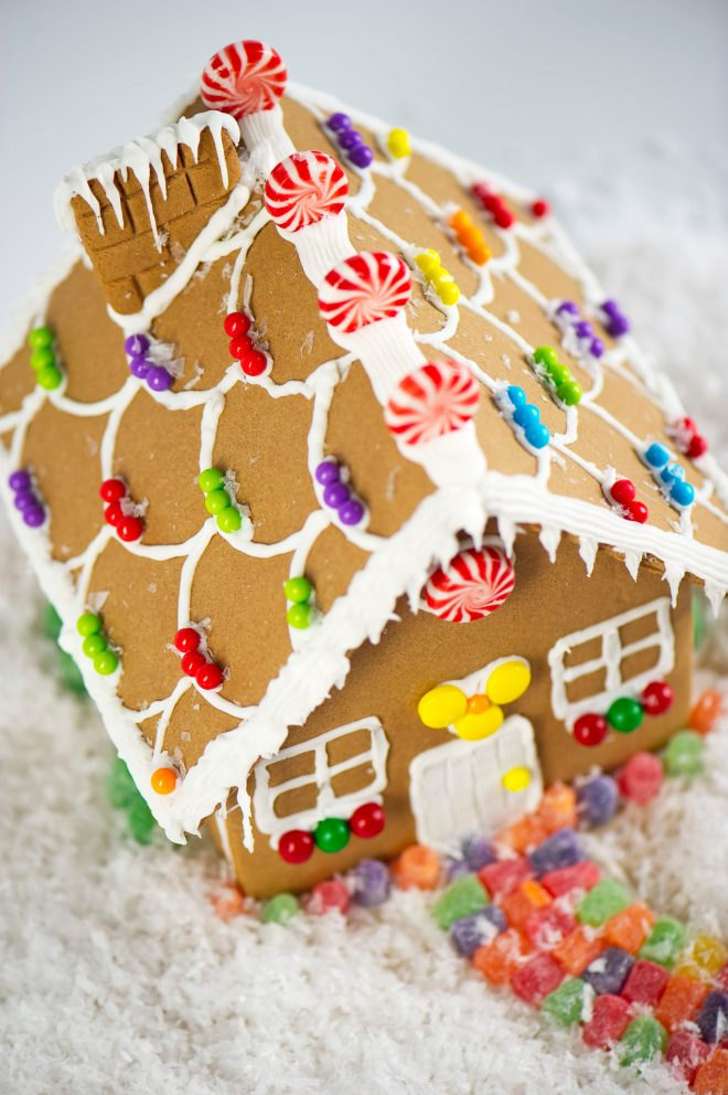 How to create a durable gingerbread house - Gingerbread cookies and houses are one of the many symbols of the holiday season, alongside Christmas trees and twinkling lights. In fact, few confections symbolize the holidays more so than gingerbread. #Gingerbread