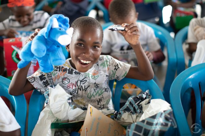 Samaritan's Purse Celebrates 10.5 Million Shoebox Gifts Collected for Children in Need - A stuffed animal and a toy car brought great joy to a boy in Botswana. | Samaritan's Purse Photo