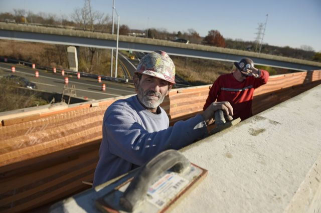 Workers on a highway bridge along Route 2 near Hartford.