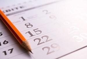Close-up of a sharp pencil on the page of a calendar