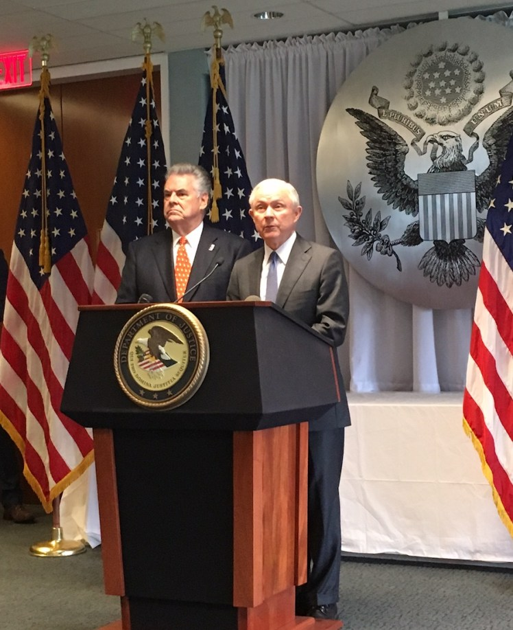 With Rep. Peter King at his side, U.S. Attorney General Jeff Sessions spoke in Long Island on April 28, 2017, in a speech where he tied lax border security to a surge in gang violence. (Photo by Adam Klasfeld, CNS)