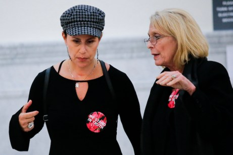 Lili Bernard, at left, talks with Victoria Valentino on June 8, 2017, as they walk out of the courtroom for a lunch break in Bill Cosby's sexual assault trial at the Montgomery County Court of Common Pleas. Both women have accused Cosby of assault, but ther claims are too old to prosecute. (Pool photo via Courthouse News Service by Eduardo Munoz Alvarez /AFP)