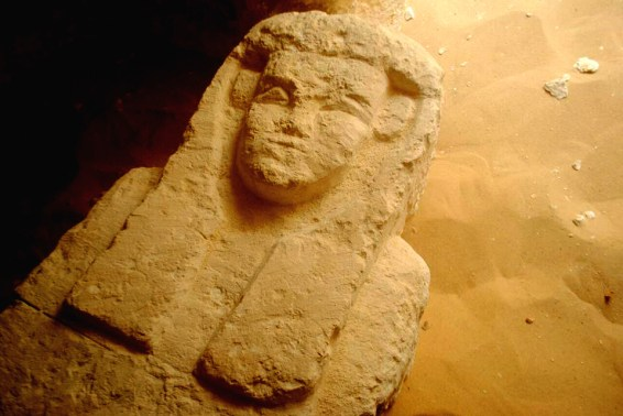 This undated photo released by the Egyptian Ministry of Antiquities shows a sarcophagus in a Ptolemaic tomb in an area known as al-Kamin al-Sahraw, in the Nile Valley province of Minya south of Cairo. Egypt's antiquities ministry says that archaeologists have discovered three tombs dating back more than 2,000 years, from the Ptolemaic Period. (Egyptian Ministry of Antiquities via AP)