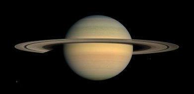 As Saturn advanced in its orbit toward equinox and the sun gradually moved northward on the planet, the motion of Saturn's ring shadows and the changing colors of its atmosphere continued to transform the face of Saturn as seen by Cassini in this image from the mission's fourth year. Cassini has been orbiting Saturn for five Earth years as of June 30, 2009. That's about one sixth of a Saturnian year, enough time for the spacecraft to have observed seasonal changes in the planet, its moons and sunlight's angle on the dramatic rings. This captivating natural color view was created from images collected shortly after Cassini began its extended Equinox Mission in July 2008. The mosaic combines 30 images-10 each of red, green and blue light-taken over the course of approximately two hours as Cassini panned its wide-angle camera across the entire planet and ring system on July 23, 2008, from a southerly elevation of 6 degrees. Six moons complete this constructed panorama (see the full-size image): Titan (3,200 miles, or 5,150 kilometers, across), Janus (111 miles, or 179 kilometers, across), Mimas (396 kilometers, or 246 miles, across), Pandora (81 kilometers, or 50 miles, across), Epimetheus (70 miles, or 113 kilometers, across) and Enceladus (504 kilometers, or 313 miles, across). Cassini captured these images at a distance of approximately 690,000 miles (1.1 million kilometers) from Saturn and at a sun-Saturn-spacecraft, or phase, angle of 20 degrees. Image Credit: NASA/JPL/Space Science Institute
