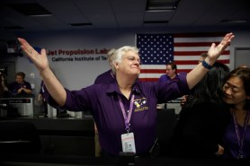 Flight director Julie Webster reacts in mission control at NASA's Jet Propulsion Laboratory after confirmation of Cassini's demise on Sept. 15, 2017, in Pasadena , Calif. Cassini disintegrated in the skies above Saturn early Friday, following a remarkable journey of 20 years. (AP Photo/Jae C. Hong, Pool)