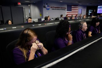 Engineer Nancy Vandermay, left, wipes her tears in mission control at NASA's Jet Propulsion Laboratory after confirmation of Cassini's demise Friday, Sept. 15, 2017, in Pasadena , Calif. Cassini disintegrated in the skies above Saturn early Friday, following a remarkable journey of 20 years. (AP Photo/Jae C. Hong, Pool)