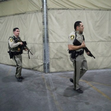 Police officers enter the Mandalay Bay resort and casino during an Oct. 1, 2017, shooting near the Mandalay Bay resort and casino on the Las Vegas Strip. (AP Photo/John Locher)