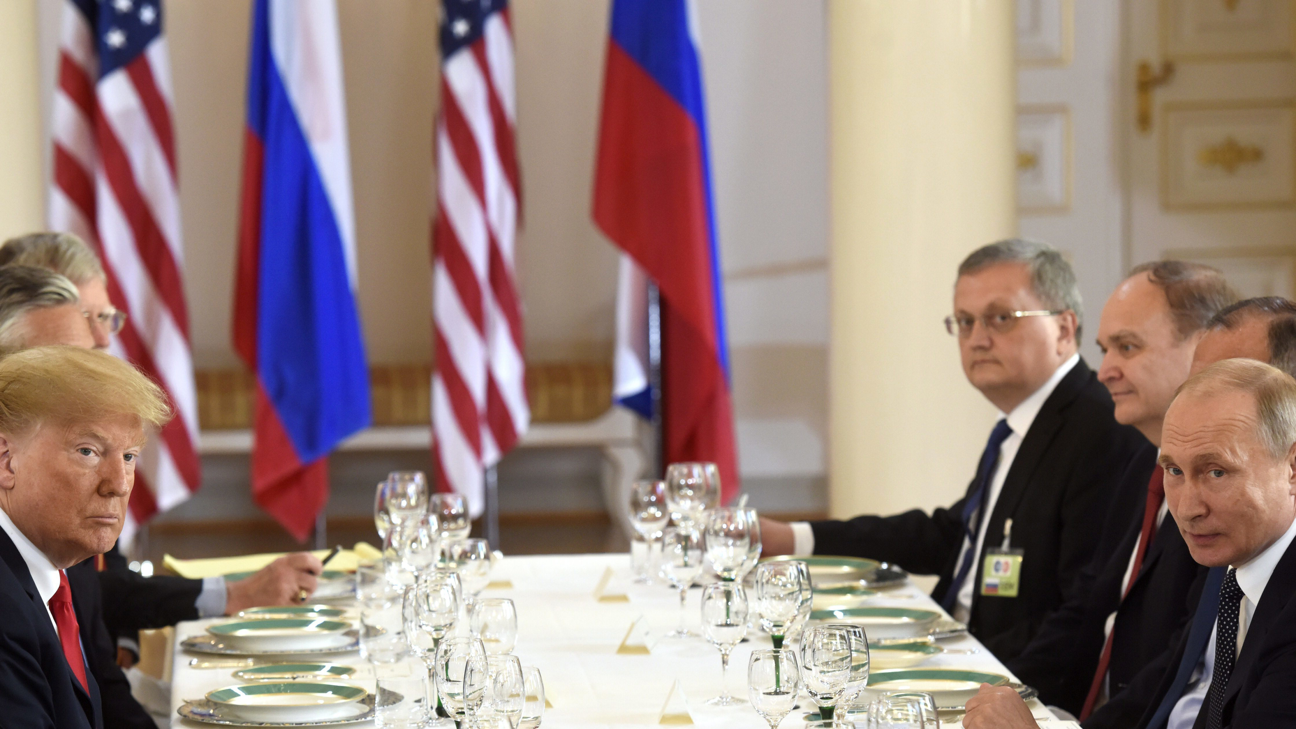 US President Of The United States America Donald Trump Left And Russias Vladimir Putin Sit Opposite Each Other During Their Working Lunch