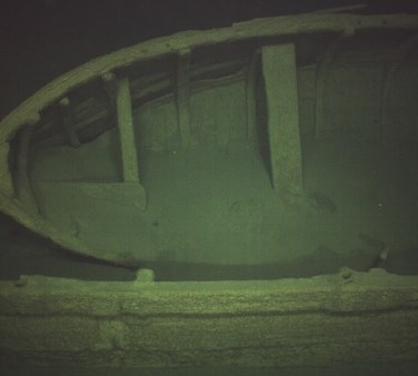 A tender boat remains attached to the deck of a 500-year-old shipwreck found at the bottom of the Baltic Sea. (MMT)