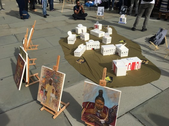 Activists erected a model of the Rikers Island jail complex outside City Hall on Sept. 5 before a land-use hearing on a proposal to close Rikers and replace it with four new borough jails. (Photo by AMANDA OTTAWAY/Courthouse News Service)