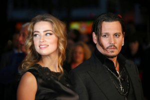 FILE - In this Oct. 11, 2015 file photo, Amber Heard, left, and Johnny Depp arrive at the premiere of Depp's film