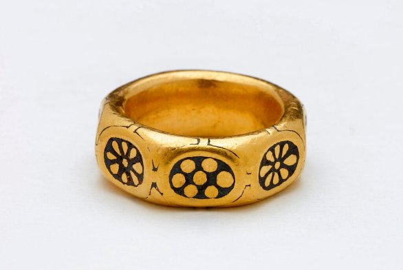 aA gold ring from the 9th century that was part of a $4 million Viking hoard that metal detectorists George Powell and Layton Davies were convicted of stealing. Two amateur British treasure-hunters were imprisoned Friday for stealing a hoard of 1,100-year-old Anglo-Saxon coins and jewelry valued at millions of dollars. Experts say the hoard, much of which is still missing, could shed new light on a period when Saxons were battling Vikings for control of England. (British Museum via AP)