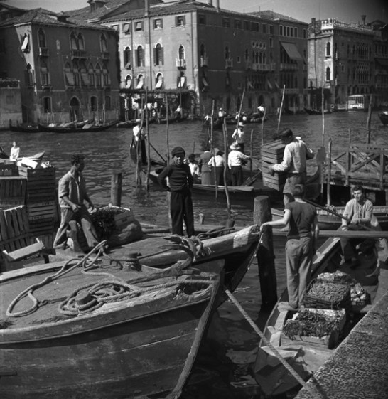 Workers enjoy a busy day on one of Venice's famed canals. (Walt Girdner photo)