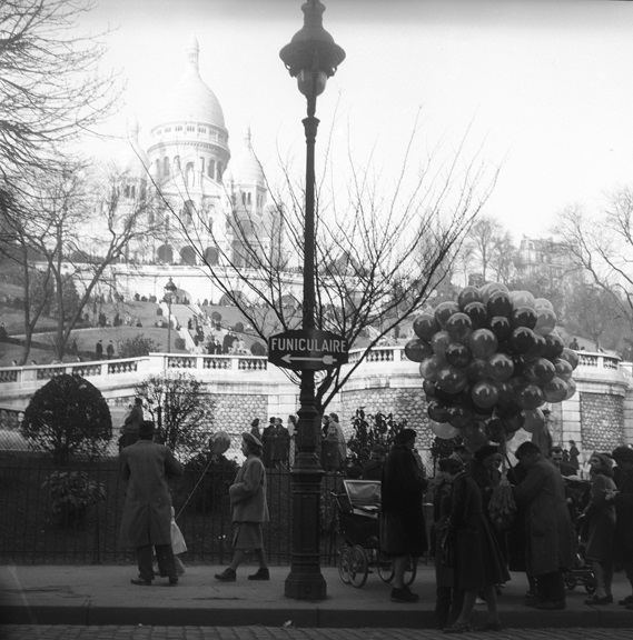 Balloon seller in the shadow of Sacre Coeur basilica. From Walt Girdner's Paris collection.