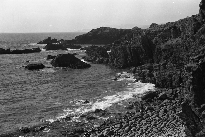 Cove on Pacific side of Baja peninsula, which can only be reached by a day off road and a morning hike. Lunch that day consisted of corbina caught in the cove, grilled over a driftwood fire, with a bottle of Mexican beer. 1968, Mexico collection.