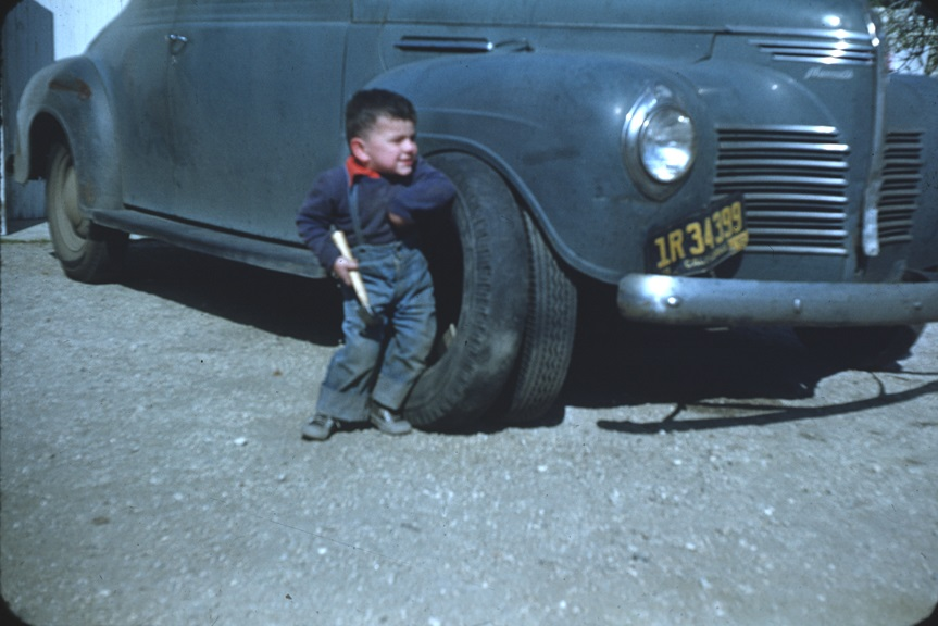 Playing in the yard. From Walt Girdner's America collection.