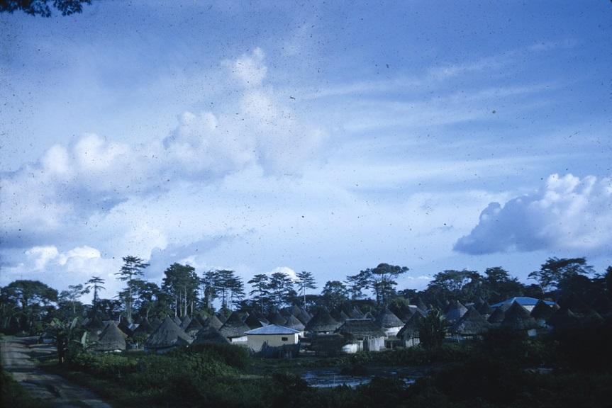 Huts and clouds. From Walt Girdner's color collection.