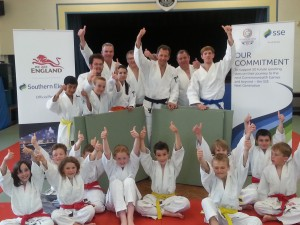Club members celebrate delivery of new tatami