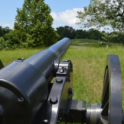 Vicksburg looking at the battlefield from behind a cannon
