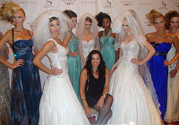 Fashion designer Mireille Dagher and models pose on the red carpet at Couture fashion Week New York