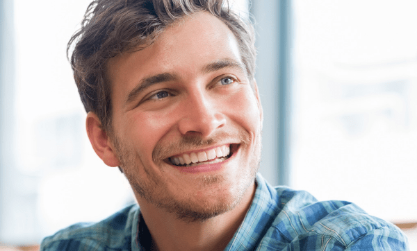 happy young man looking at friend