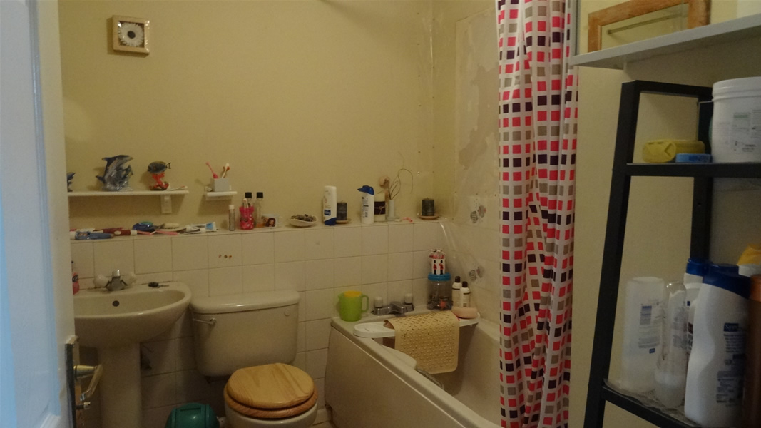 New Bathroom Fitted After Tiles Fall From Bathroom Wall