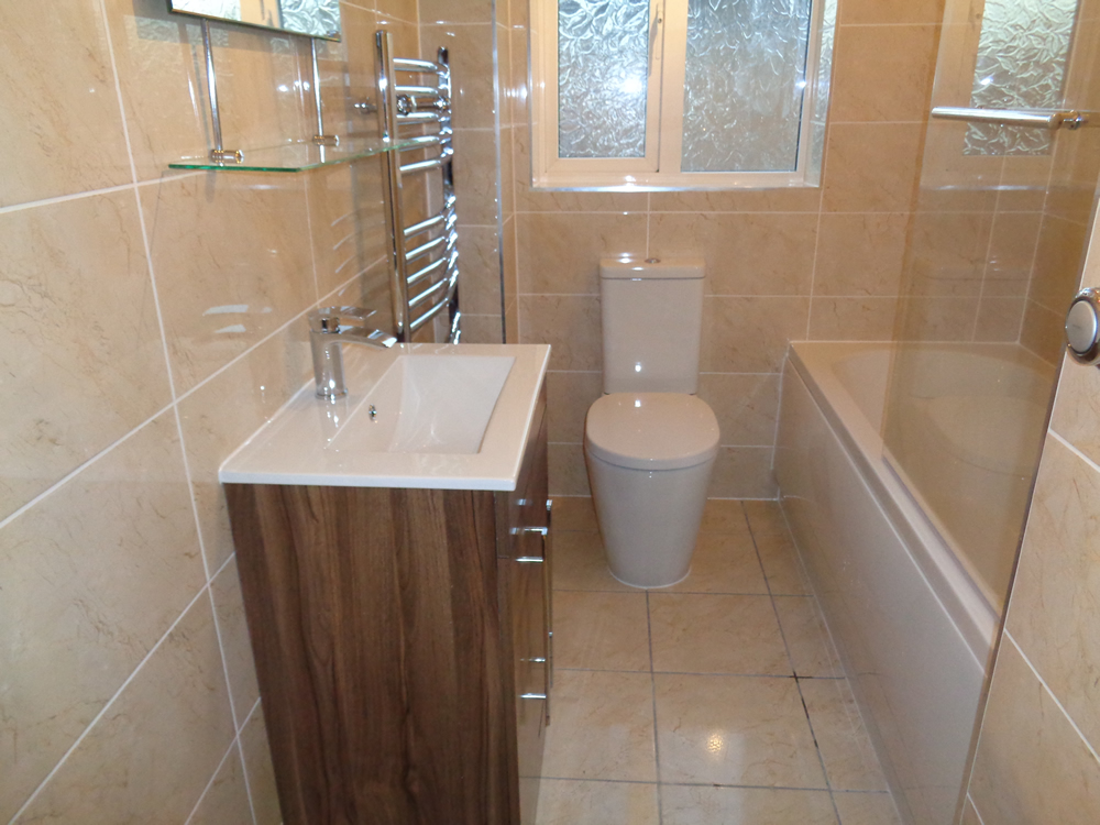 Power Shower Fitted In New Bathroom With Walnut Vanity Basin