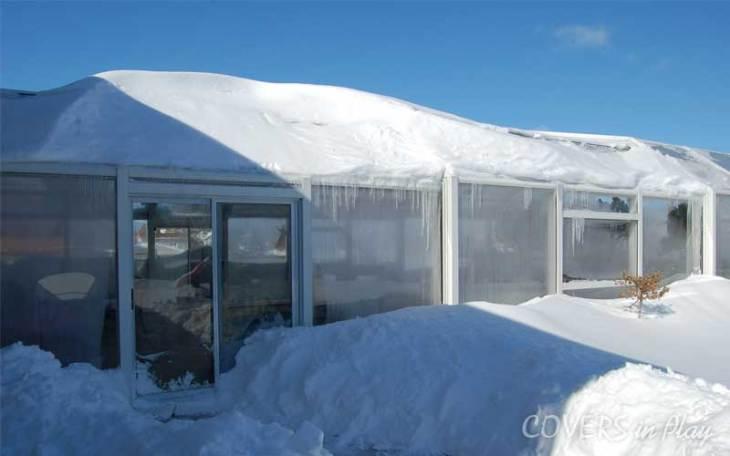 Heavy snow on pool enclosure