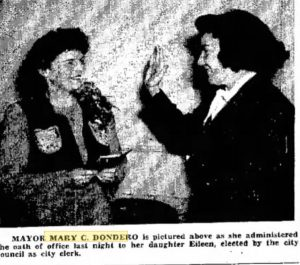 Mary (Carey) Dondero being sworn in in 1946 from a local newspaper.