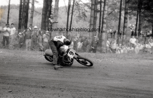1955 Races were held in Laconia. This view is of Number 9 who spilled and is trying to right himself and his motorcycle.