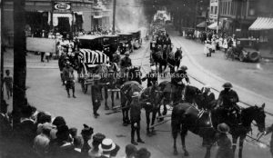 Double World War I funeral procession in Granite Square, Manchester NH. Horse drawn caisson with two flag-draped coffins. Manchester Historic Photoprint Collection, 1989.038L. Manchester (NH) Historic Association. Used with Permission.