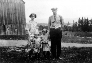 """Photograph of the Currier family of Pittsburg NH: Nettie (Witherell) Currier, Andrew """"Long Tom"""" Currier, and their two daughters, Ruth and Edna."""