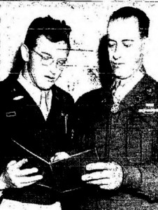 "Sgt. Christos H. Karaberis, right, holder of the Congressional Medal of Honor and newest member of the Army and Air Force recruiting station at 10th and Jackson Streets, shows his CMH citation to Capt. A.L. Caldwell, recruiting offer. Karaberis received the Nation's highest military decoration from President Truman for wiping out five German machien guns nests single-handed. ""I only wish finding a place to live was half as easy,"" Karaberis said.--Tribune photo"