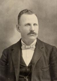 Lyman M. Stearns of Goffstown, Derry and Manchester NH.  Talented player of American checkers, shoemaker, publisher and salesman.  Photograph from CHECKERS.  Stearns' Book of Portraits of Prominent Players of the World, &c. by L.M. Stearns, Derry Depot, N.H. 1894