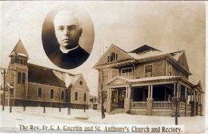 Photograph postcard of the old St. Antoine/Anthony Parish church and rectory.