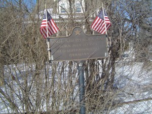 Photograph of Joseph H.W. Roux's recognition plaque, located in Manchester NH  at the NW corner of Bartlett and Amory Streets. Copyright of Martin Miccio for  the City of Manchester, and used here with permission.