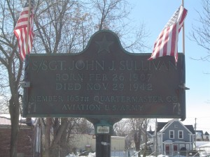 Photograph of John J. Sullivan recognition plaque, located in Manchester NH at the corners of Massabesic Street and Valley Street. Copyright of Martin Miccio for the City of Manchester, and used here with permission.