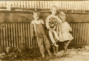 Berwin H. Webster with sister's Anna and Margaret.  Posing against a fence in Merrimack NH circa 1918.