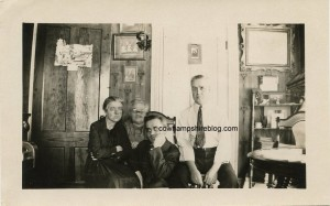 """Photograph of a family with a ghostly """"grandma. """"Unknown location, probably a double exposure taken in the 1920s. Purchased by the editor on an online auction website. Property of Janice Brown at Cow Hampshire Blog."""