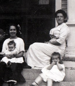 My grandmother (seated R) with her daughter Anna (bottom step) and son Berwin (the baby being held by unidentified woman).
