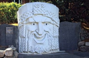 """Muse of Comedy,"" the art deco head originally from the State Theatre in Manchester NH, now sitting on the campus of St. Anselm College."