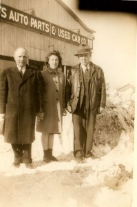 Rare photo-- Sam and Saul (or Saul and Sam) Weisman/Waisman circa 1945 (so you have to be a little old to remember this). They ran two businesses, the Howe Street Garage at 450 Howe Street near where A-1 Auto is to repair cars. They also owned Cy's Auto Parts & Used Cars at 268 Elm in Manchester NH. I am pretty sure this photo was taken at the dealership on Elm Street. Pictured here in the middle, between the Weisman brothers, is my mom, then Mary Manning. She was their accountant for a few years.