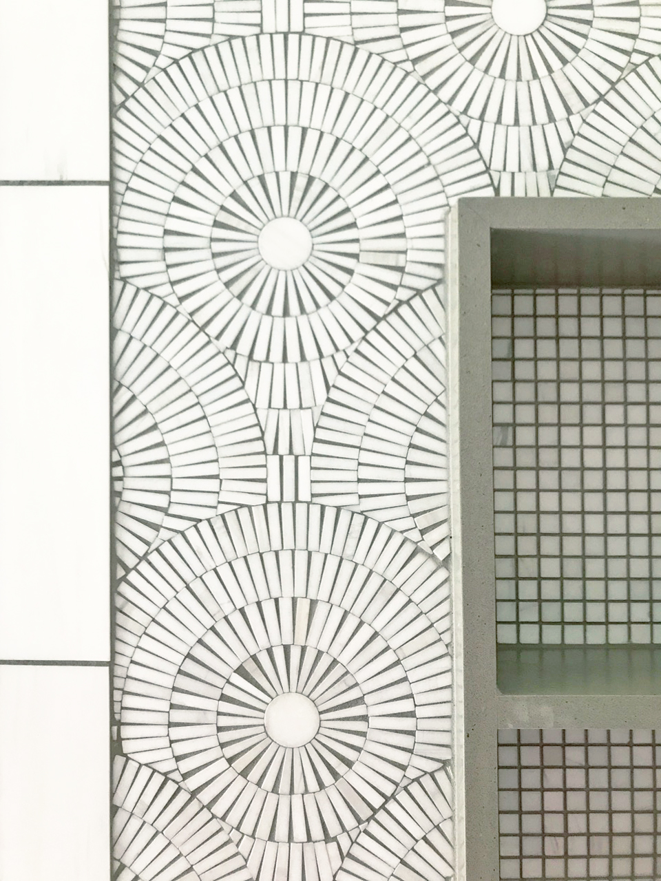 Artistic Tile white and grey mosaic tile shower niche detail