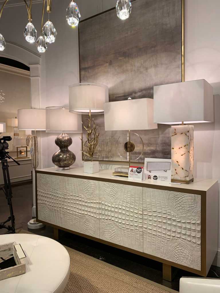 Textured crocodile hide cabinet with various lamps Spring 2019 Design Trends - High Point Market