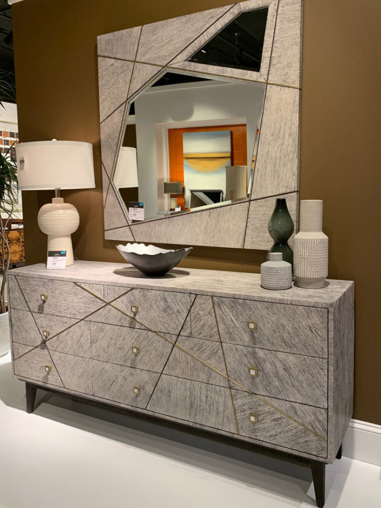 Wood grain parquetry mirror and chest drawers at Highpoint Market