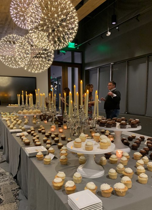 table of cupcakes at Signature Kitchen Suite