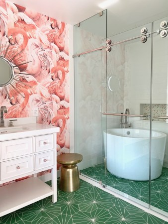 Pink and green Teen bathroom with flamingo wallpaper