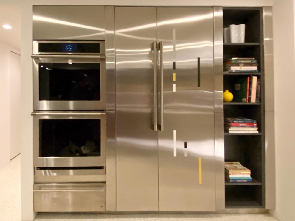 Stainless steel Statement Collection convection wall oven and refrigerator by Monogram Appliances at the Kirk Douglas Estate Kitchen - Palm Springs