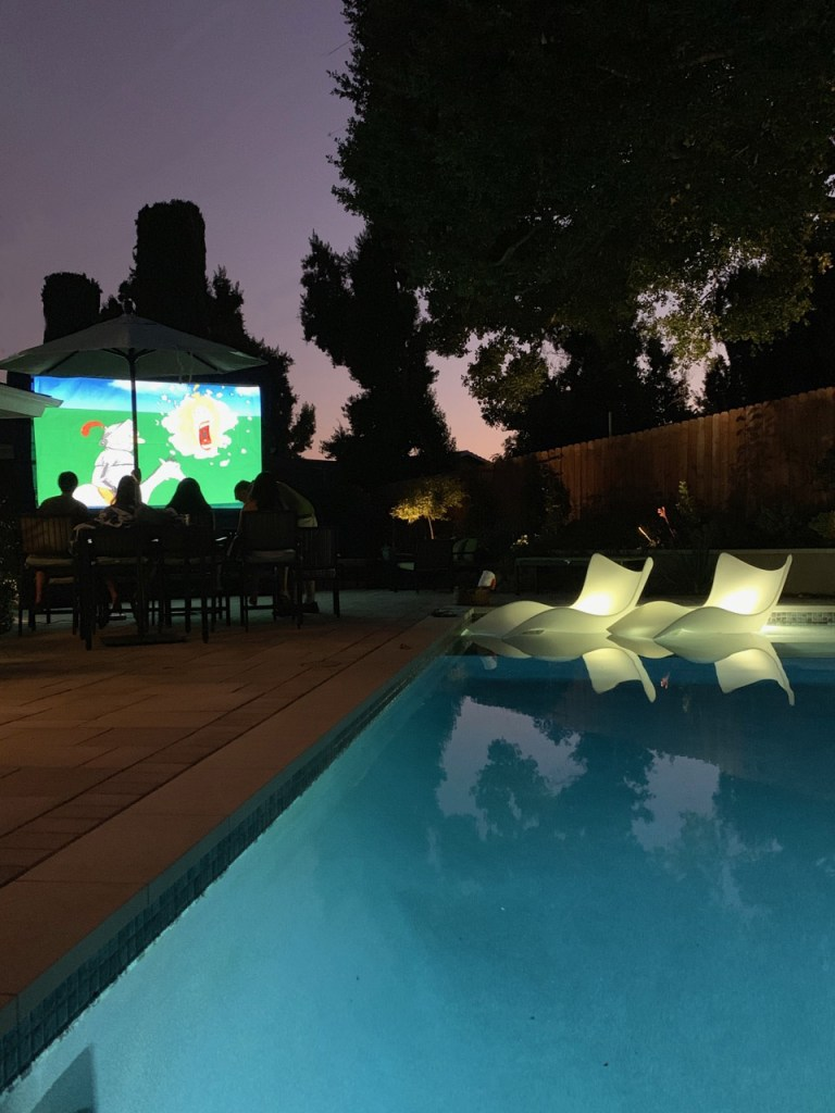 Movie night out by the pool in a Sierra Madre backyard.